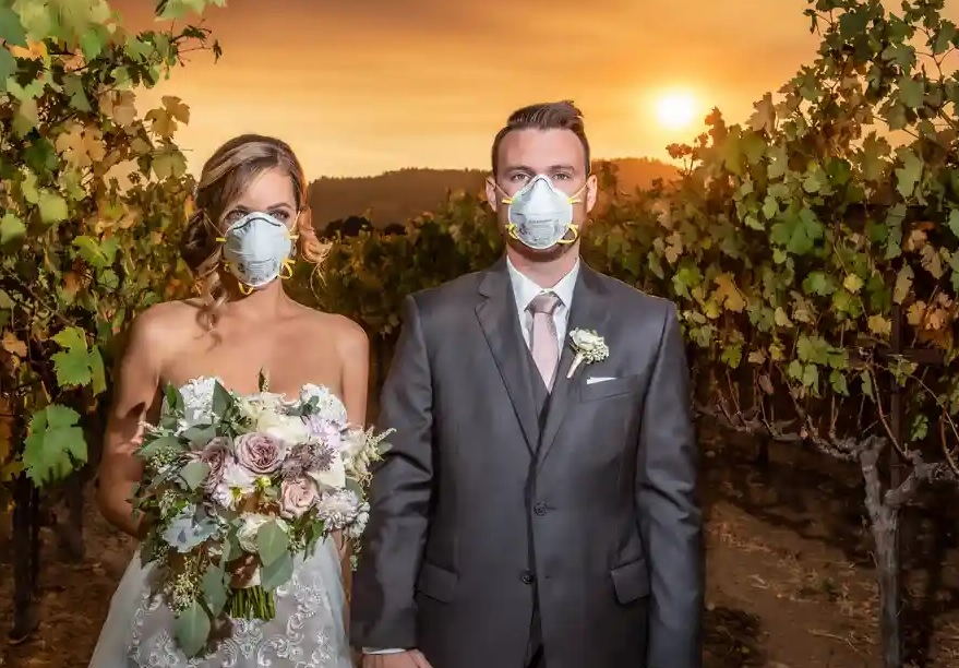 Bride and groom tie the knot during California fires, early in 2020. Seen wearing face masks, prior to Coronavirus outbreak.