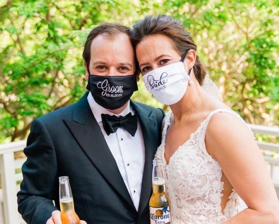 Bride and groom exchange vows, yet kissing may be put on hold in post-lockdown era face mask-wearing wedding ceremonies. Wedding photo editing companies relish retouching possibilities.