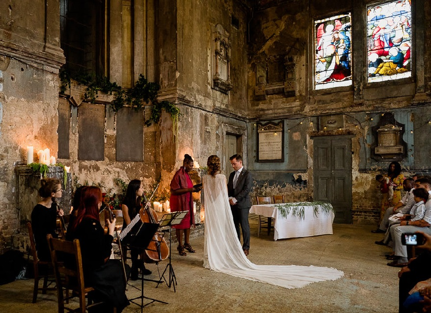 There's a lot wedding photo correction services could do to digitally enhance this image. Short of replastering the walls of this Top 10 Unique UK Wedding Venues example.